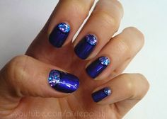 gorgeous blue polish with glittery details