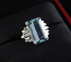 A late 1960's platinum, aquamarine and diamond set -