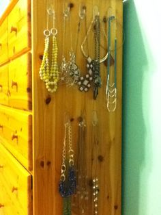 Need a place to hang necklaces? Put Command hooks on the side of your dresser.