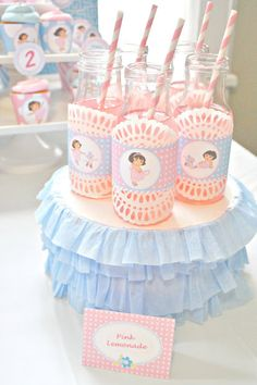 round box painted white with crepe paper ruffles. Starbucks bottles washed and decorated.