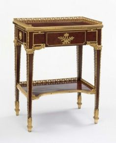 "Table à écrire, c. 1780-85; Paris, France; mahogany and ""plum-pudding"" mahogany veneers and holly banding on oak; gilt-bronze mounts. Oblong, of harewood, drawer and sides paneled by beaded bronze dore, encasing female masks on right and left sides, drawer and rear with escutcheons. Attributed to Jean-Henri Riesener. MFA Boston (65.2505)"