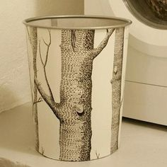 Wrap an inexpensive metal trashcan in wallpaper for instant polish! Check out the inventory at your local Habitat ReStore! #SiouxlandHabitat