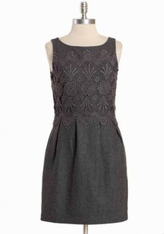 charcoal gray tailored wool blend has a beautiful blue-gray lace overlay and pleats to accentuate the skirt