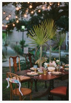 Outdoor wedding reception  Bride & Groom seating decor with handcrafted paper flowers by Thrifty Chic Love.