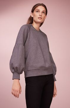 Love this bell sleeved sweater. It's Burberry. Would like something similar.