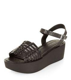 Sandales noires effet peau de serpent à plateforme plate et brides tissées
