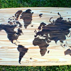 I think this is an awesome idea specially if you have travelled a lot.  World Wood Map by  MELISSA RIKER