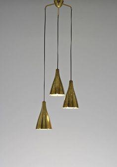 A Paavo Tynell  triple-pendant lamp.