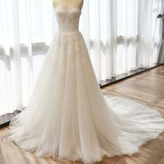 Charming Sweetheart Long A-line Appliques White Tulle Wedding Dresses, WD0153 The wedding dresses are fully lined, 4 bones in the bodice, chest pad in the bust, lace up back or zipper back are all ava