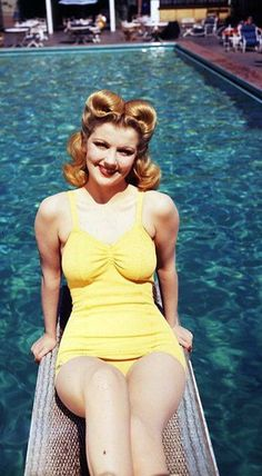 Old Hollywood:: Classic Pin Up:: Pin Up Summer:: Retro Hair Inspiration 40s yellow bathing suit hair rolls victory pool