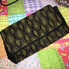 Antique beaded purse Beautiful black purse with black iridescent & bronze iridescent beading. The sides have black beading. Bags Clutches & Wristlets