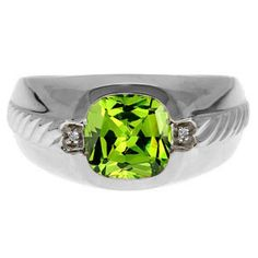 Men's Peridot and Diamond Accent Ring In Sterling Silver Gemologica.com offers a unique selection of mens gemstone and birthstone rings crafted in sterling silver and 10K, 14K and 18K yellow, white and rose gold. We have cool styles including wedding and engagement rings, fashion rings, designer rings, simple stone and promise rings. Our complete jewelry collection of gemstone rings for men can be seen here: www.gemologica.com/mens-gemstone-rings-c-28_46_64.html