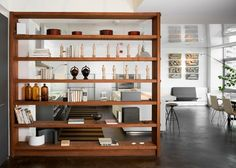 A room divider fills the space & separates the functions of different parts of a large room