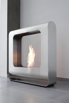 "ethanol fireplaces ""The culmination of modernity"" Modern bio ethanol fireplaces designs are mostly glass and steel, especially in the uncoated silver colour. A silver bio ethanol fireplace by Doramar is an example of this ultra modern design. It is entirely made ​​of polished stainless steel. It is characterized by a very simple, square shape, but rounded edges give softness and airiness to the whole structure ..."