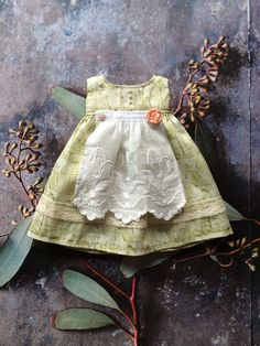 This dress is made from a lovely liberty print with little ships in palest fresh green. It has a delicate apron made from vintage lace, and lots