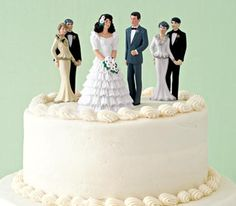 Figurines of bride, groom, parents and in-laws on a wedding cake