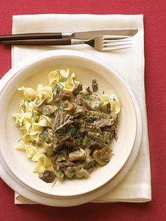 Use a slow cooker or Dutch oven to simmer sliced beef chuck with onion and mushrooms. Just before you're ready to serve the stroganoff, thicken the sauce with cornstarch and stir in sour cream and Dijon mustard.