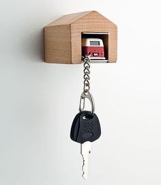 Cairo is selling a rack that look like a mini garage. It comes with a little bitty Porsche, Karmann Ghia, Jaguar E-Type, VW bus, or Beetle key chain that you can park so you never lose your keys ag...