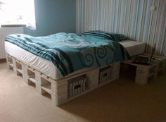 Pallet bed with cubbys cut for baskets.