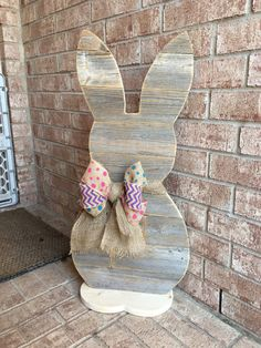 Wood Standing Bunny, Easter Bunny Reclaimed Wood, Front Porch Decor 31 inches tall. Perfect for your front porch. Made from reclaimed wood. The sign is hand painted. The sign is sanded painted and slightly distressed to give it that desirable rustic. Its guaranteed to brighten up your door. We also make wreath for you. Just convo with your request or idea and we will work with you to make the wreath of your dreams. Keep checking back for new designs. We also specialize in handmade wood…
