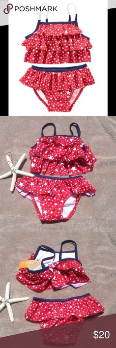 "UPF Protection Red Stars Bikini Set This cute bikini set provides UPF 50+ sun protection, and has layers of ruffled star print. Navy blue trim, gives this a patriotic flair. Fully lined. Bottoms have the matching ruffled detail, and are fully lined. 6-12 mo fits height 25-29"", weight 17-22lbs. 12-18 mo fits height 29-31"", weight 22-27 lbs. 18-24 mo fits height 31-33"", weight 27-30lbs. Swim Bikinis"