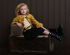 www.frostedproductions.com | #utah #photographer #studio #photography #brown #wood #background #children #fashion #outfit #ideas #curled #hair #vintage #chest #child #model