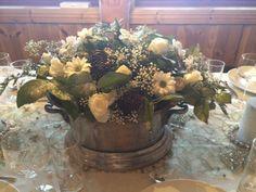 Flower arrangement in a Champagne bucket/cooler.