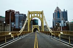 The Roberto Clemente Bridge in perfect symmetry and downtown Pittsburgh, PA. #Pittsburgh #PA #Pennsylvania #bridges #bridge #RobertoClemente  #yellow #architecture #engineering #downtown #urban #skyline #cityscape #landscape #sky #buildings #skyscrapers #suspension #cables #street #symmetry #symmetric #middle