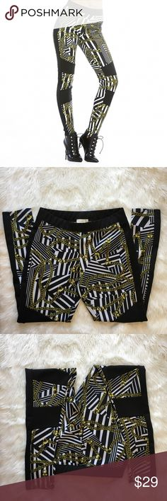 Gold Chains Rococo Scuba Pants Joggers Womens XL Nicki Minaj Geometric Gold Chains Rococo Scuba Pants Joggers Womens XL Geometric chain print Colorblock detailing Smooth look These scuba leggings have a skin-like fit with a kiss of sheen. A colorblock stripe down the side and insets at the legs define this urban look. Elasticized waist. 95% polyester, 5% spandex. Machine wash.  Excellent condition Pants