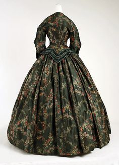 Afternoon Dress 1852, American, Made of silk    I really cannot get behind the print or color scheme, but the line of the bodice back is lovely.