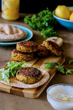 Spiced millet and chickpea burgers with preserved lemon yoghurt