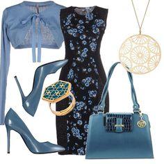 Un outfit dai toni e dalle fantasie delicate. Abito nero in una deliziosa fantasia floreale azzurra abbinato a scaldacuore azzurro. Décolleté azzurra con tacco a stiletto. Borsa azzurra con inserto nero a doppi manici. Anello con incisione in ceramica azzurra, collana con ciondolo finemente lavorato.