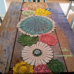Vintage crocheted colorful doilies dyed like spring flowers and repurposed upcycled into a doily table runner by Sadie Seasongoods / www.sadieseasongoods.com