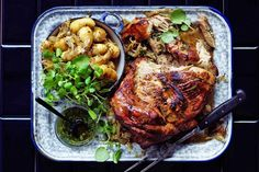 Slow-cooked pork shoulder with lemon and winter herbs - Recipes - delicious.com.au