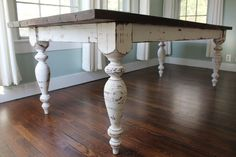 """This is a large antique white farm table made from mostly reclaimed pine. It is very sturdy and hand crafted using traditional woodworking techniques. The table has a rich mahogany stain and a distressed antique white base. Hand turned legs are fastened with mortise and tenon joinery. Dimensions are as follows:    93""""L / 40""""W / 31"""" H. (1.5"""" thick top)    Table seats 8 comfortably.    Shipping isn't available at this time. Local pickup or delivery only. Delivery in the DFW metroplex available…"""