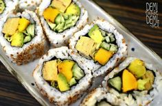 Delicious vegetarian rolls! avocado, tamago(?), cucumber and ripe mango - all rolled in sesame seeds.
