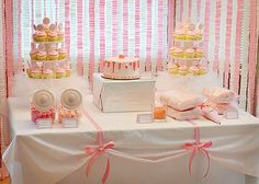 Love the ribbon holding up the table cloth & the sewed crinkly streamers in the background.