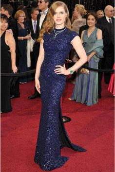 Amy Adams  parted ways from her look in The Fighter with an elegant midnight-blue L'Wren Scott gown and Cartier emerald-and-diamond jewelry. More:  Hollywood beauty experts' 	makeup tips and tricks for redheads