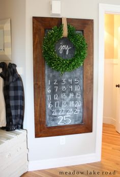 christmas home This has to be one of the easiest Advent calendars weve seen: Simply use a framed chalkboard to create a Chalkboard Advent Calendara boxwood wreath adds a Christmas touch. Christmas Time Is Here, Christmas Love, Christmas Countdown, All Things Christmas, Winter Christmas, Christmas Wreaths, Christmas Calendar, Christmas 2019, Christmas Lights