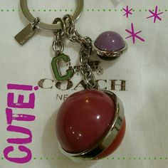 Coach Key / Purse Fob NWT beautiful fob! Each ball consists of two colors. Dark purple, light purple, magenta and mauve colors. Trade value $60 Coach Accessories Key & Card Holders
