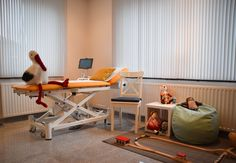 Midwife practice, medical office, ultrasound, examiation table, stork, play corner for kids.