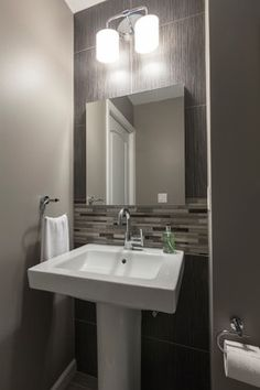 Pedestal sink alcove with glass mosaic accent. contemporary design. metallic details. small bathroom makeover. #interiordesign  rel-interiors.com
