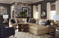 What do you think about this living room from Bassett? It combines chevron, stripes, plaid, and Moroccan prints! #Bassett