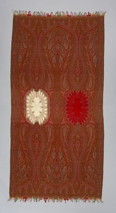 Paisley (Scotland) shawl, wool, 1860s, showing a French all-over pattern. The layout (influenced by oriental rugs) combines medallions and vegetal elements arranged to create a three-dimensional effect – a composition introduced by Antony Berrus, a French designer of the time. The huge scrolling volutes and curving sprouts cover almost a quarter of the surface. The length of the shawl (about 3.5 m) is also at a maximum. Kashmiri Shawls, Paisley Scotland, Textile Museum, Textiles, Ethnic Dress, Oriental Rugs, Date, Zig Zag, Three Dimensional