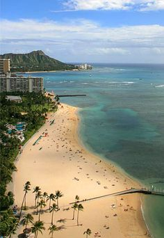 Dr. Beach's Top 10 Beaches, 2012: Kahanamoku Beach, Waikiki, Oahu, Hawaii #2.: This beach was named in honor of Duke Paoa Kahanamoku, a gold-medal Olympic swimmer who is credited with introducing surfing to the wider world. Kahanamoku Beach is bordered by the Ala Wai small-boat harbor and the Hilton Hawaiian Village catamaran pier. A shallow reef protects this beach from big waves, making it a great swimming area for families with children