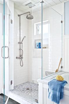 The light-filled shower enclosure boasts a marble bench—faced to look 4 inches thick—and marble pebble tile for a daily foot massage. Pebble tile: Stone Center Online Wall tile: Daltile Shower fittings: Rohl Shower window: Marvin Windows and Doors White Shower, White Bathroom, Bathroom Colors, Small Bathroom, Pebble Shower Floor, Shower Walls, Bath Shower, Glass Shower, Shower Faucet