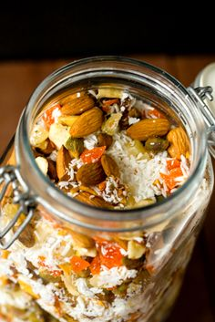 Homemade Trail Mix  1½ cups unsweetened coconut flakes   1 cup almonds   1 cup pistachios   1 cup dried banana chips (broken in half or quarters if large)   ½ cup chopped dried dates   ½ cup chopped dried mango   ½ cup chopped dried papaya   ½ cup chopped dried pineapple