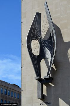 'Winged Figure', 1963, by Dame Barbara Hepworth. Aluminium and stainless steel rods, height 5.8m, on wall of John Lewis store, Oxford Street,London.