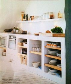 Love the open lower shelves with fat walls between, and think the wood with white is nice contrast.