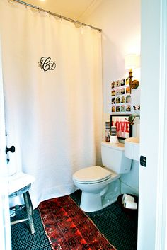 Love the black tile with white grout!  (and the monogrammed shower curtain is a cute idea too!)